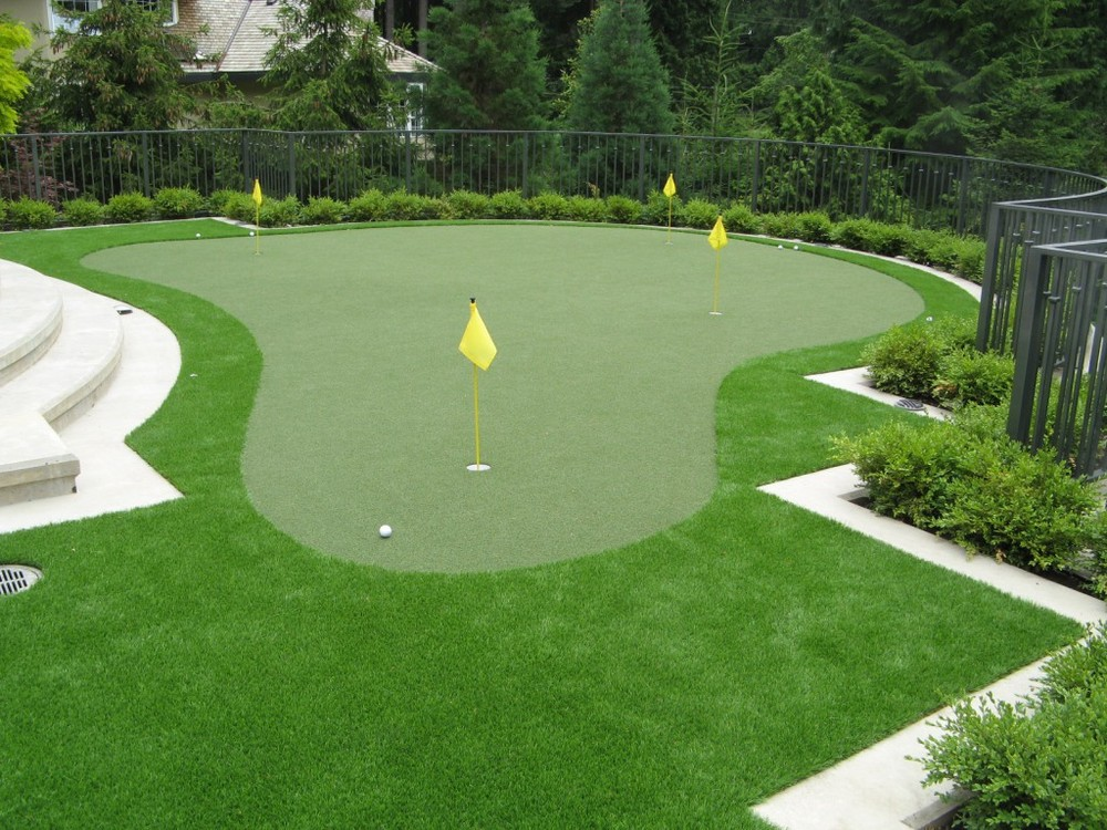PUTTING GREENS   A putting green is the perfect secret weapon for an avid golfer. It's maintenance-free, eco-friendly, and open year-round.