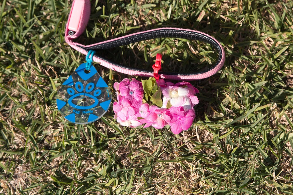 Bag buddy and blinged out flower dog poop bag holder by Drool of Happiness