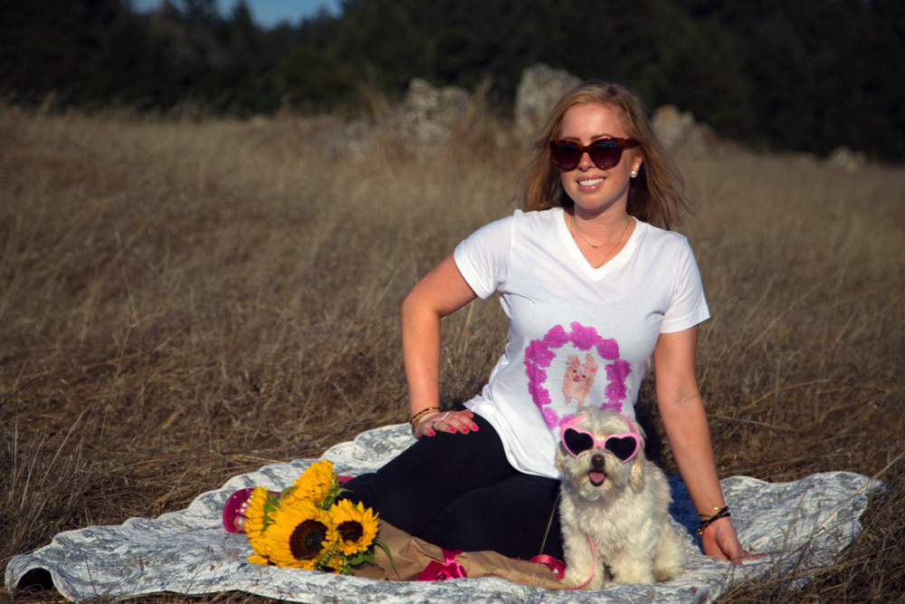 Katie Robert wearing the dog shirt she designed to help dog rescue groups