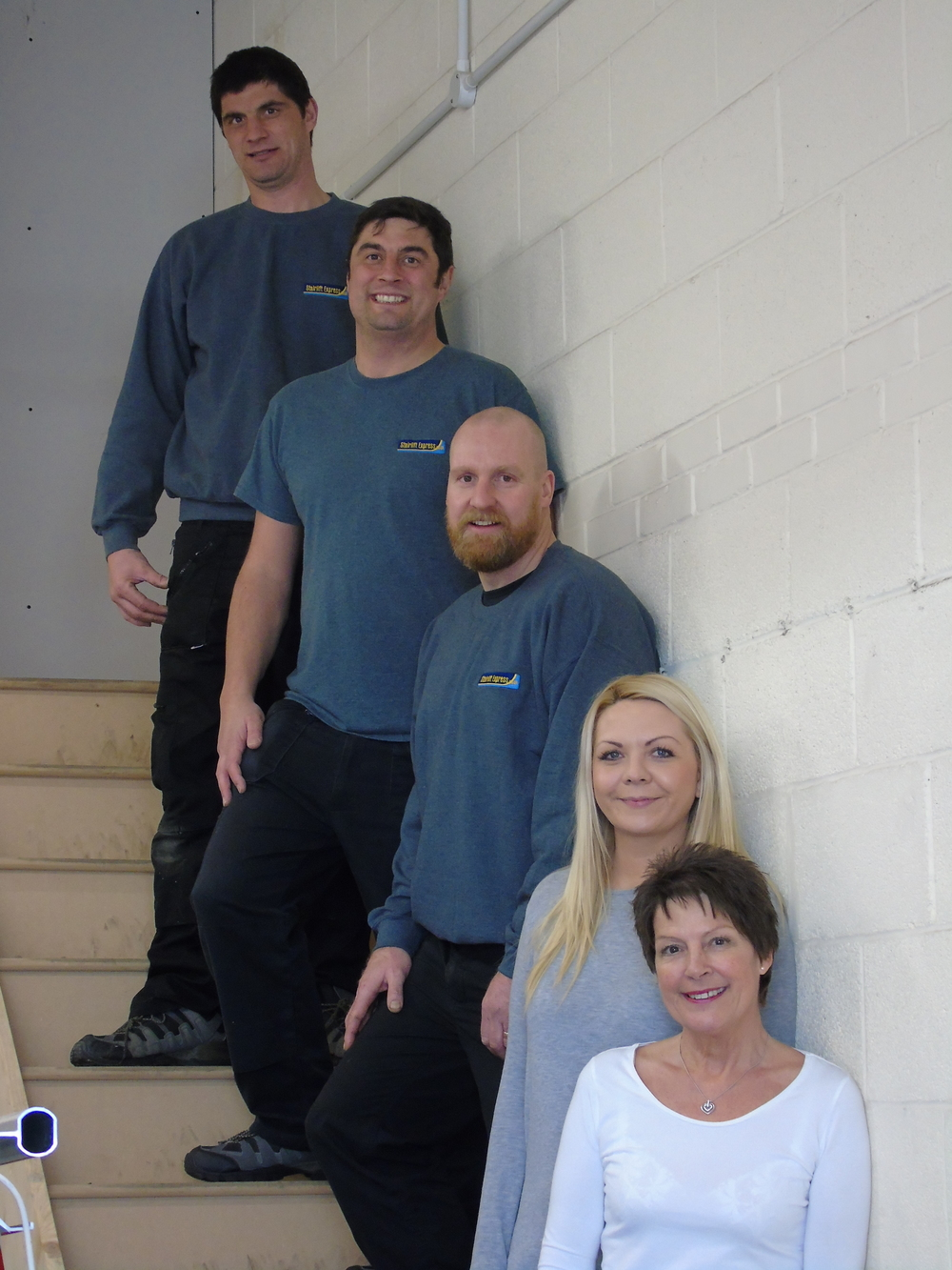 team on stairs close up.JPG