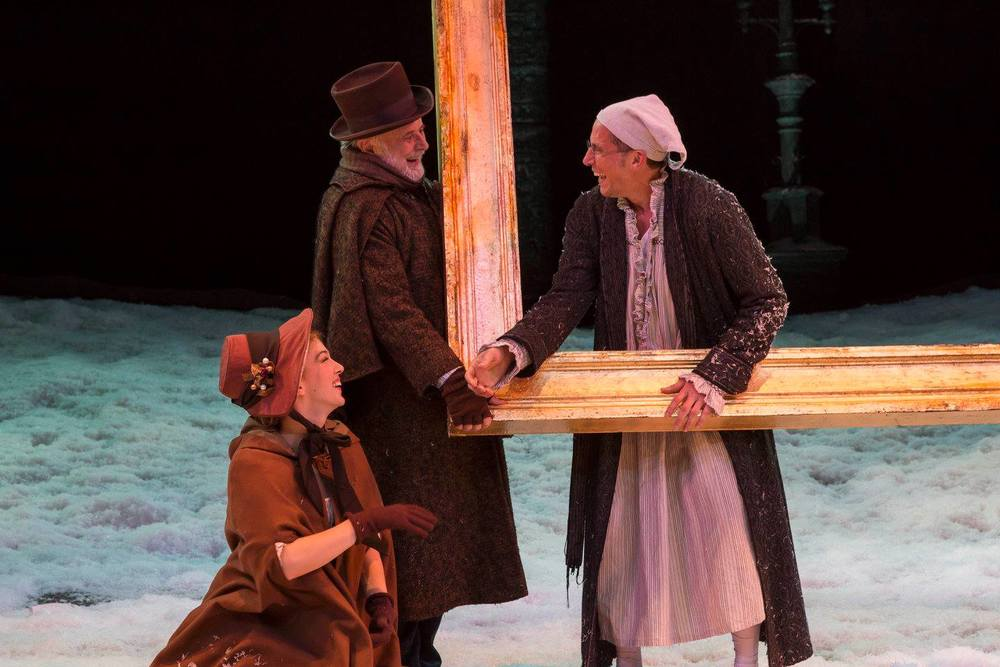 Eliza Simpson, Mark Goetzinger and Ryan Artzberger in IRT's 2015 production of A Christmas Carol. Photo by Zach Rosing.