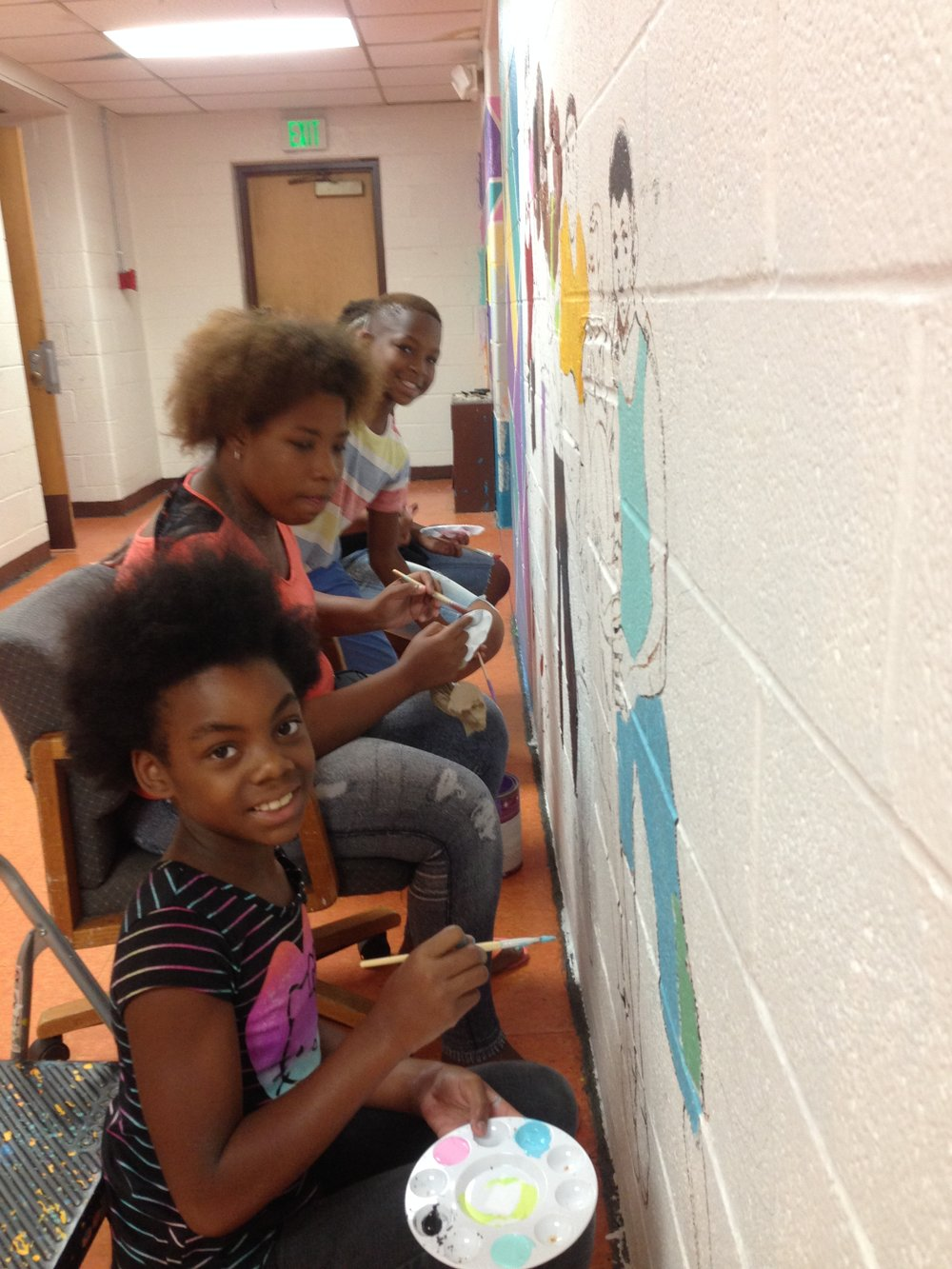 LJR artists working on their mural