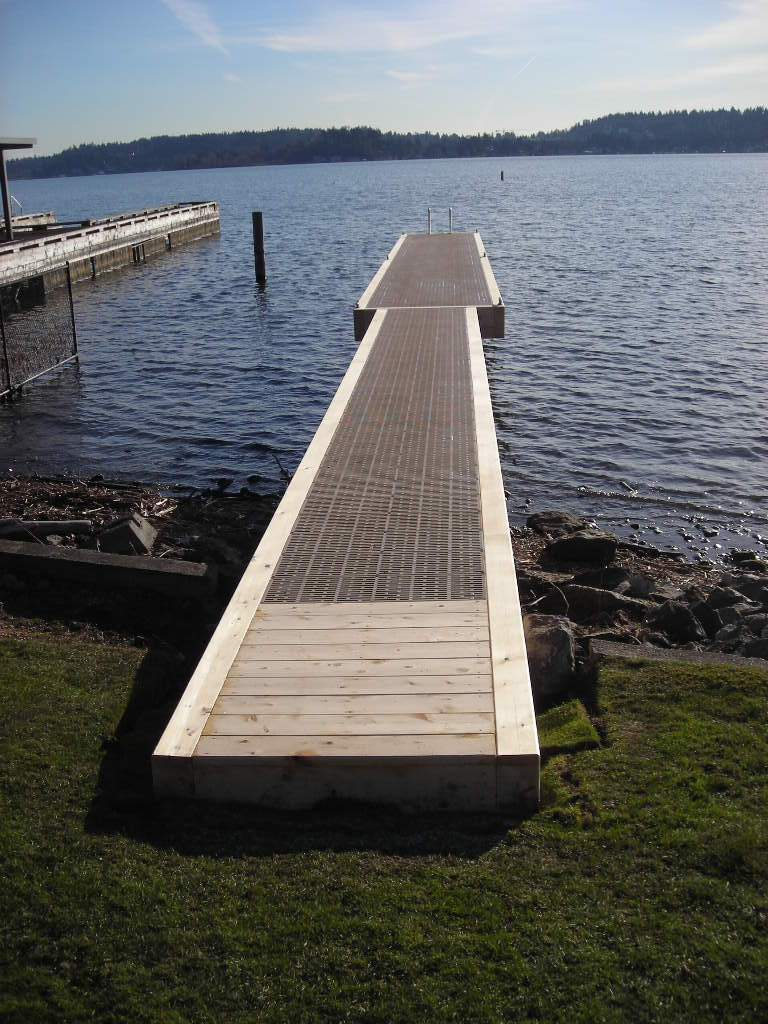 Wood footed dock construction