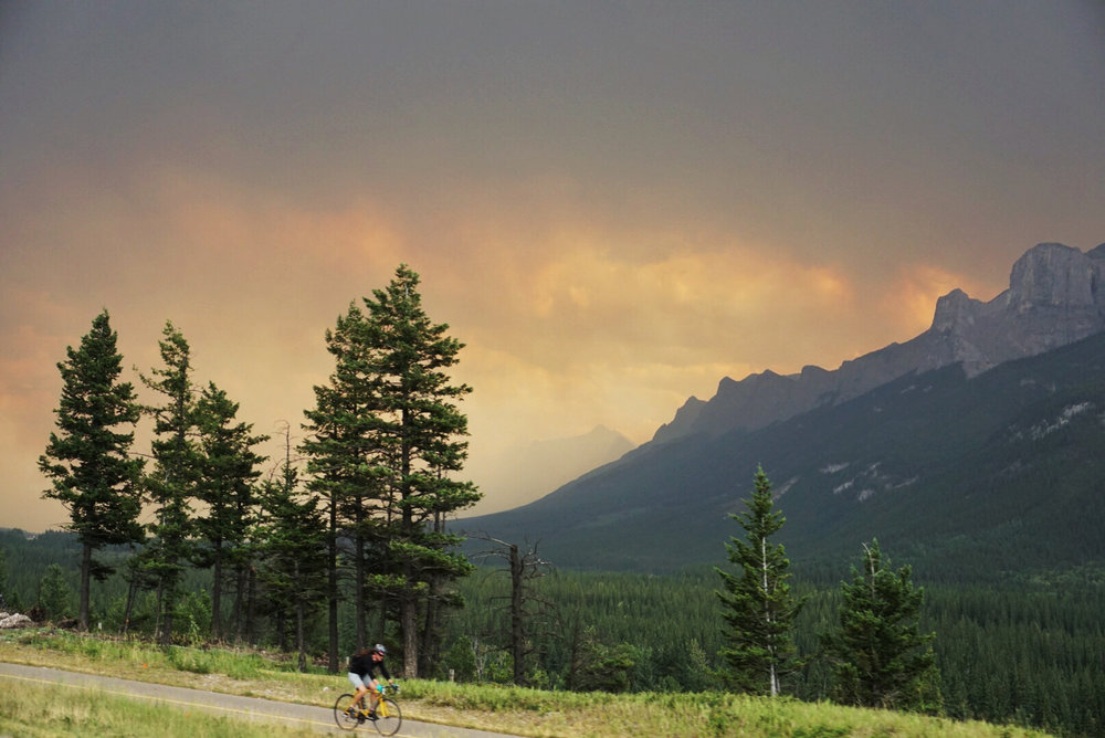 Smokey skies as we drove into Canmore, AB. I just love the colors on this pic. I took it from the car as we were driving and that cyclist timed himself perfectly to get in the shot :)