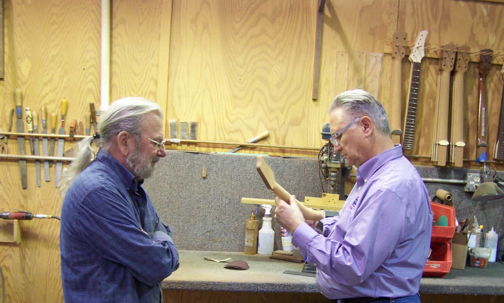 Doc and Jean are evaluating the shape of the neck for playability.