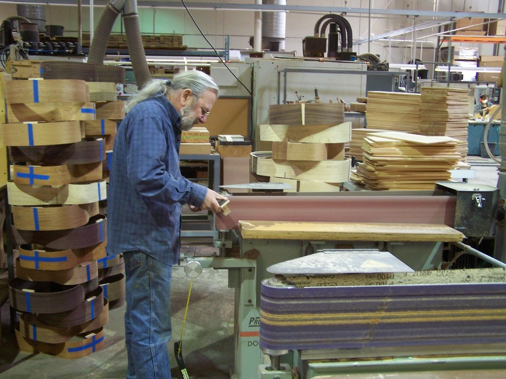 Here Jean, our luthier, is working in his manufacturing workshop, shaping the neck and adding the final touches prior to assembly.
