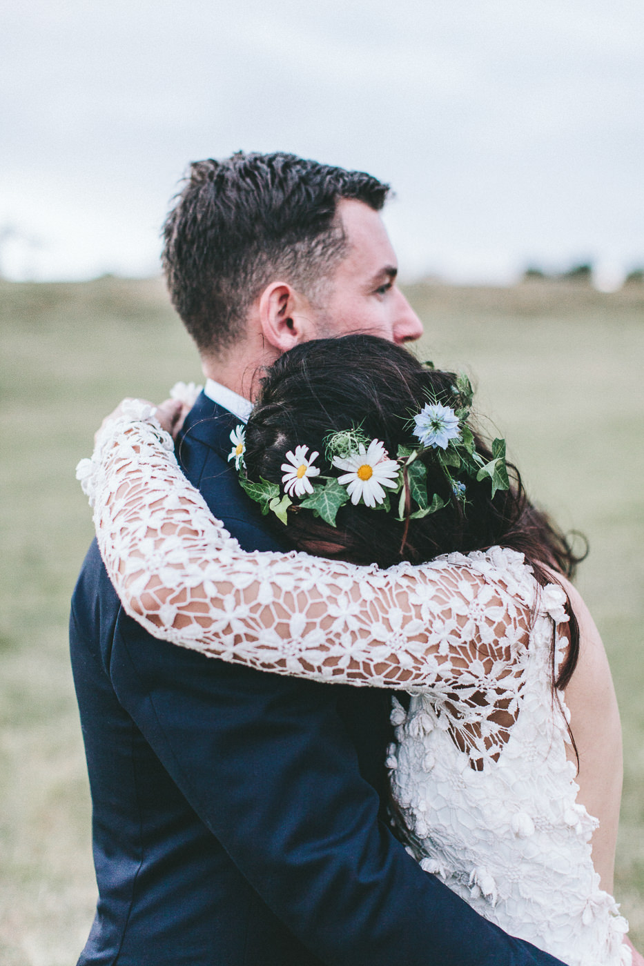 Bride and groom with floral crown