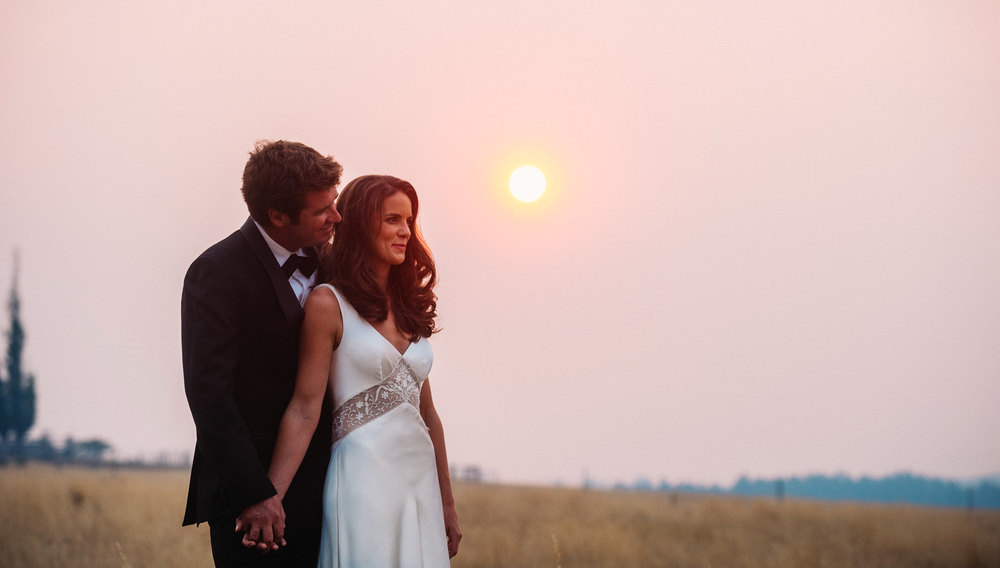 Bride and groom before sunset with amazing smoke haze