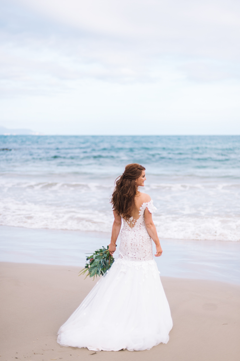 Beautiful Nurit Hen gown on Avalon Coastal Retreat's private beach
