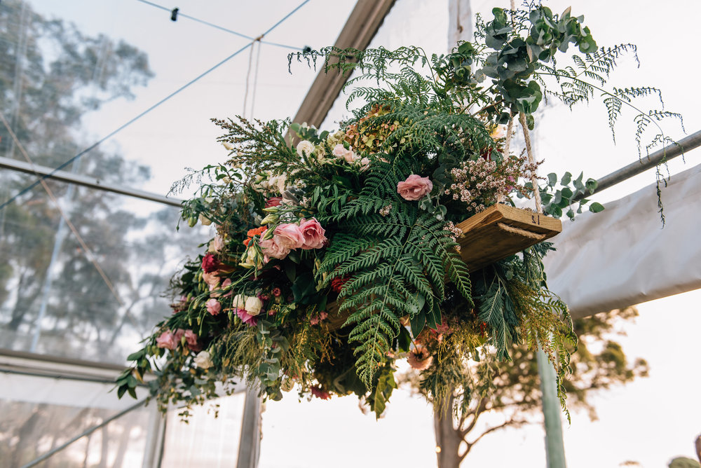 Floral swing in the clear marquee at Goaty Hill