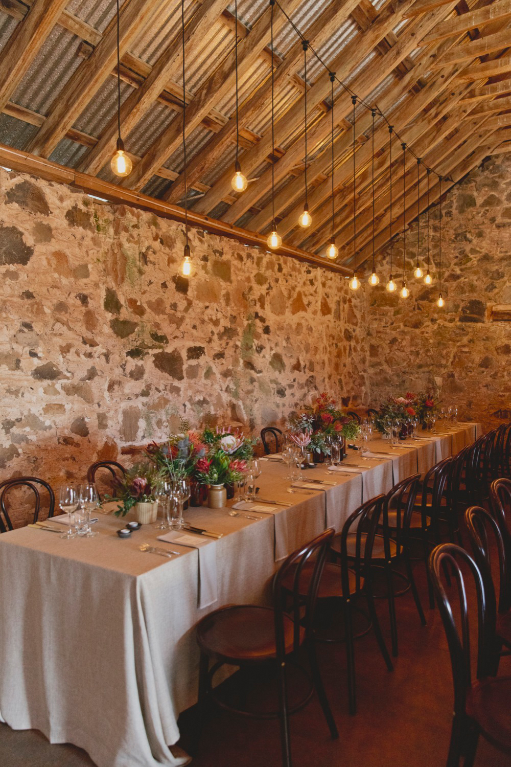 Barn at Highfield House Stanley. Tables dressed with Di Simmons linen
