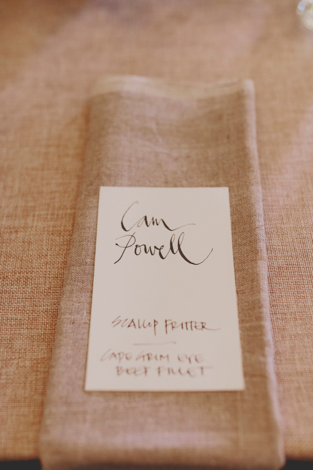 Hand written place cards on hand made linen napkins