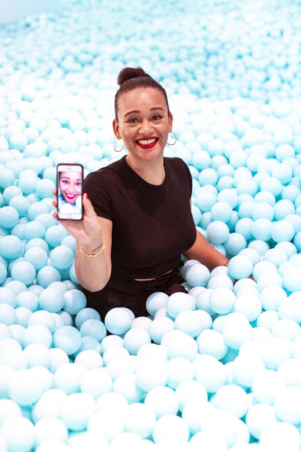 Me, in the blue ball pit at Color Factory…