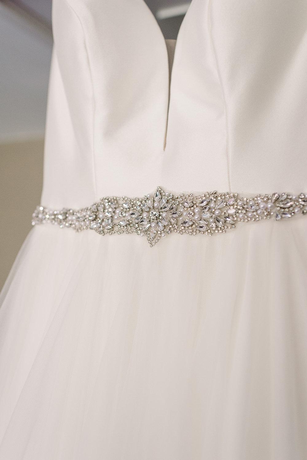 jewelled belt on bride's wedding dress