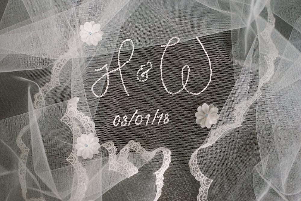 bride and groom's initials on wedding veil