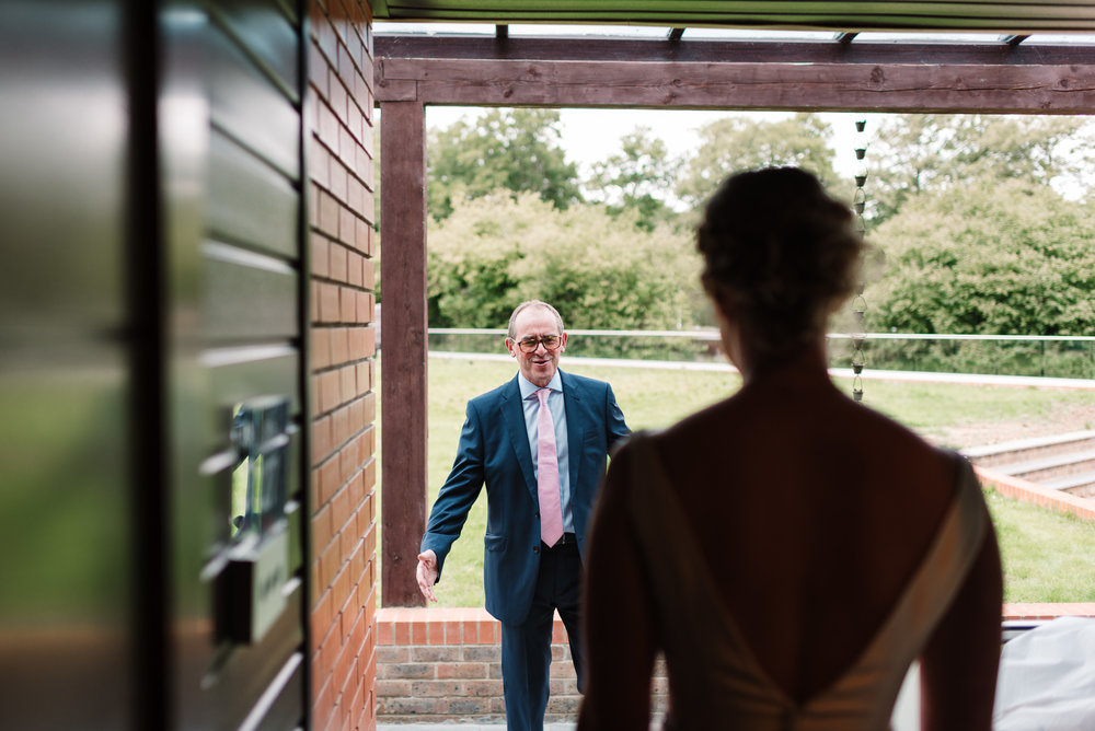 bride's father seeing his daughter in her wedding dress