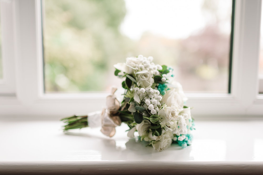 wedding bouquet of roses on windowsill