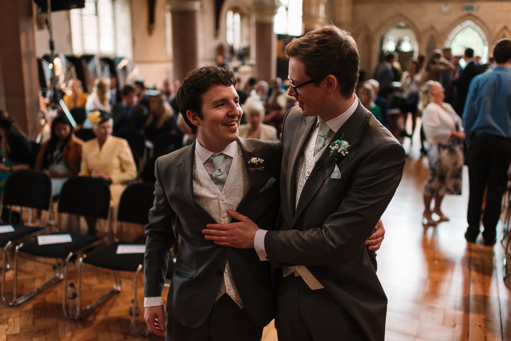 groom and best man in st saviour's church before wedding ceremony