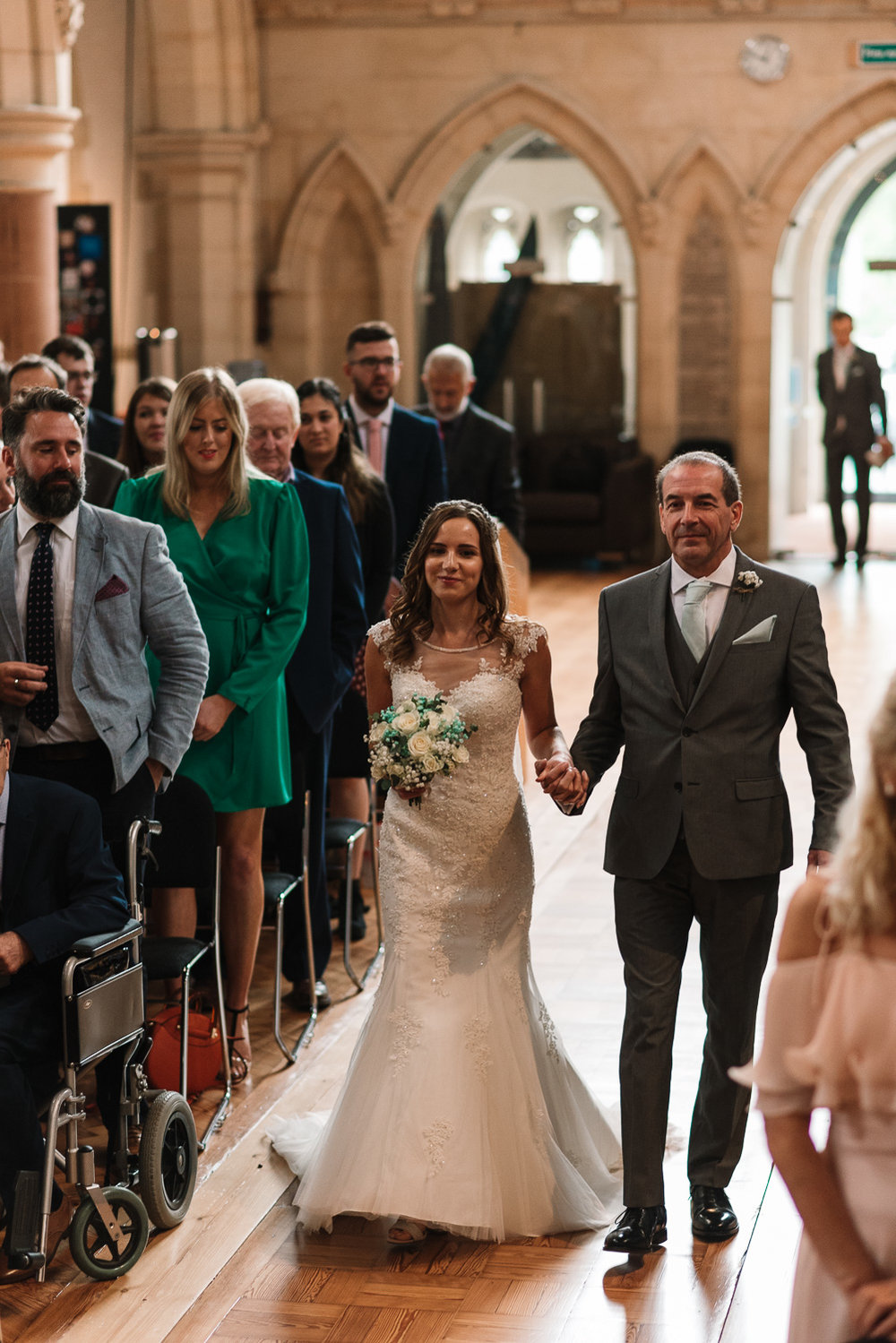 bride and father walking down aisle at st saviour's church guildford