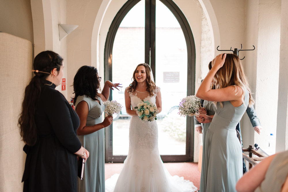 bride and bridemaids about to walk down aisle