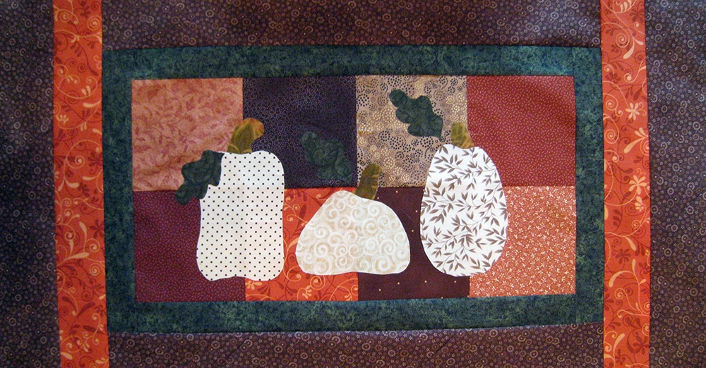 Pumpkin table runner needs a bit of quilting.