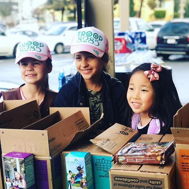 These cuties sold 80 boxes of cookies yesterday!! We have more!! #troop8285 #rainorshine