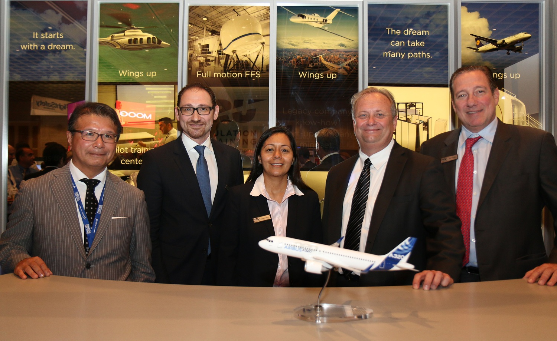 Company executives finalize agreement during 2015 World Aviation Training Symposium in Orlando.