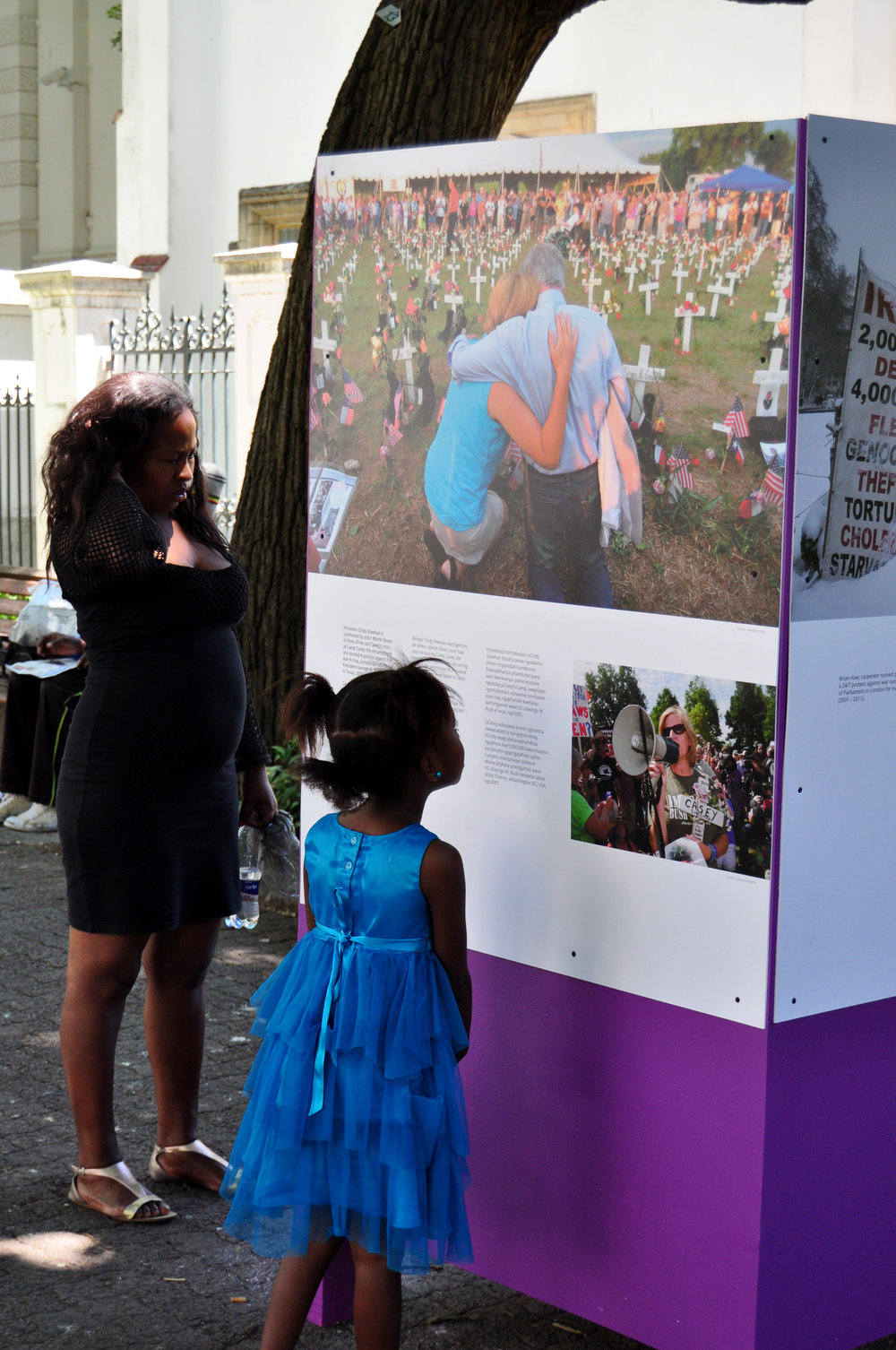 A young girl stops to read one of the exhibition pieces.