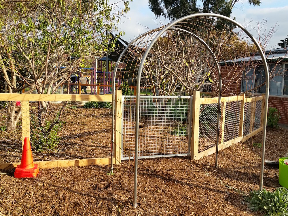 chook fence and archway.jpg