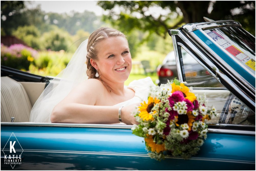 Bride in vintage blue car
