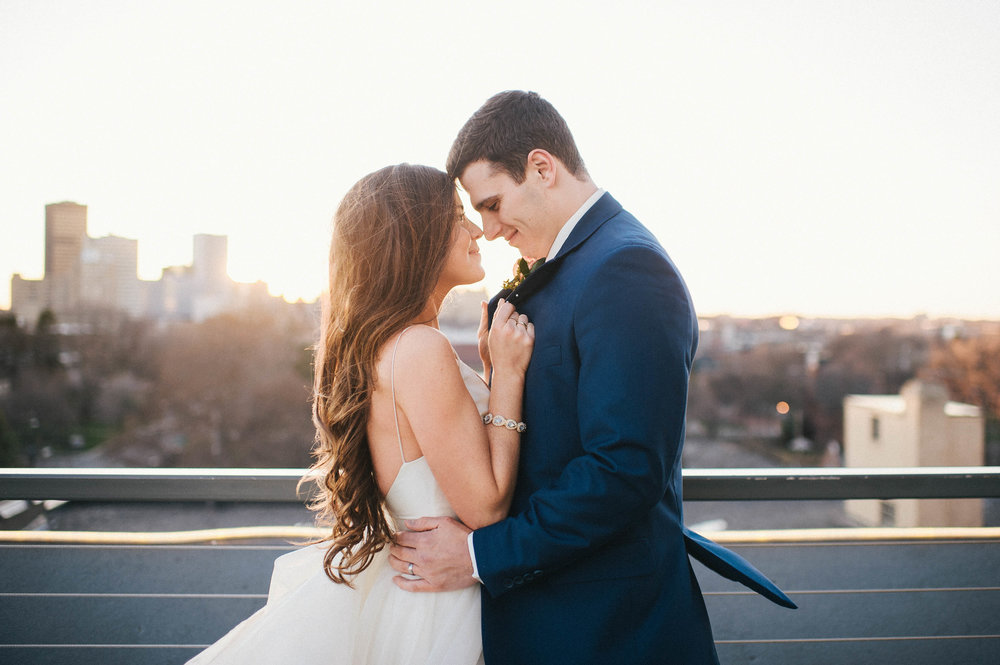 hello there! - I'm Katie and I'm so happy that you've found my online home! This is me and my handsome husband on OUR wedding day, in front of the skyline of the city we live and love in - Rochester, NY.I am a lifestyle + fine art wedding and engagement photographer available throughout Rochester,Buffalo, the Finger Lakes, and beyond! I love creating an intimate and fun experience for my clients from our initial meeting through to the delivery of a collection of images; your memories preserved as everlasting works of art.Learn more about me here!