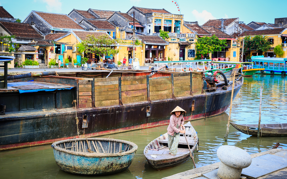 adventure-photography-motorcycle-vietnam-becky-brockie-hoian-woman-boat.jpg