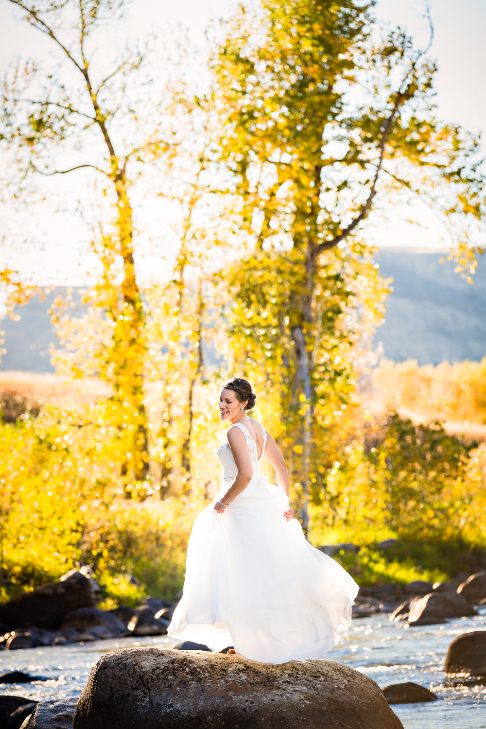 absaroka-beartooth-wilderness-montana-wedding-reception-bride-crosses-river.jpg