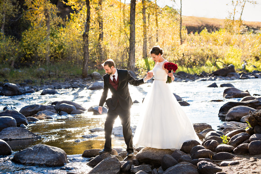 absaroka-beartooth-wilderness-montana-wedding-reception-couple-crossing-river.jpg