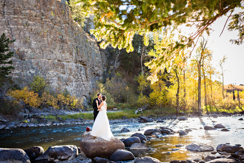 absaroka-beartooth-wilderness-montana-wedding-reception-couple-along-river.jpg