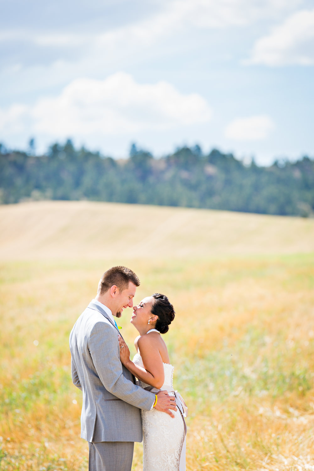 billings-montana-chanceys-wedding-first-look-bride-groom-hug.jpg