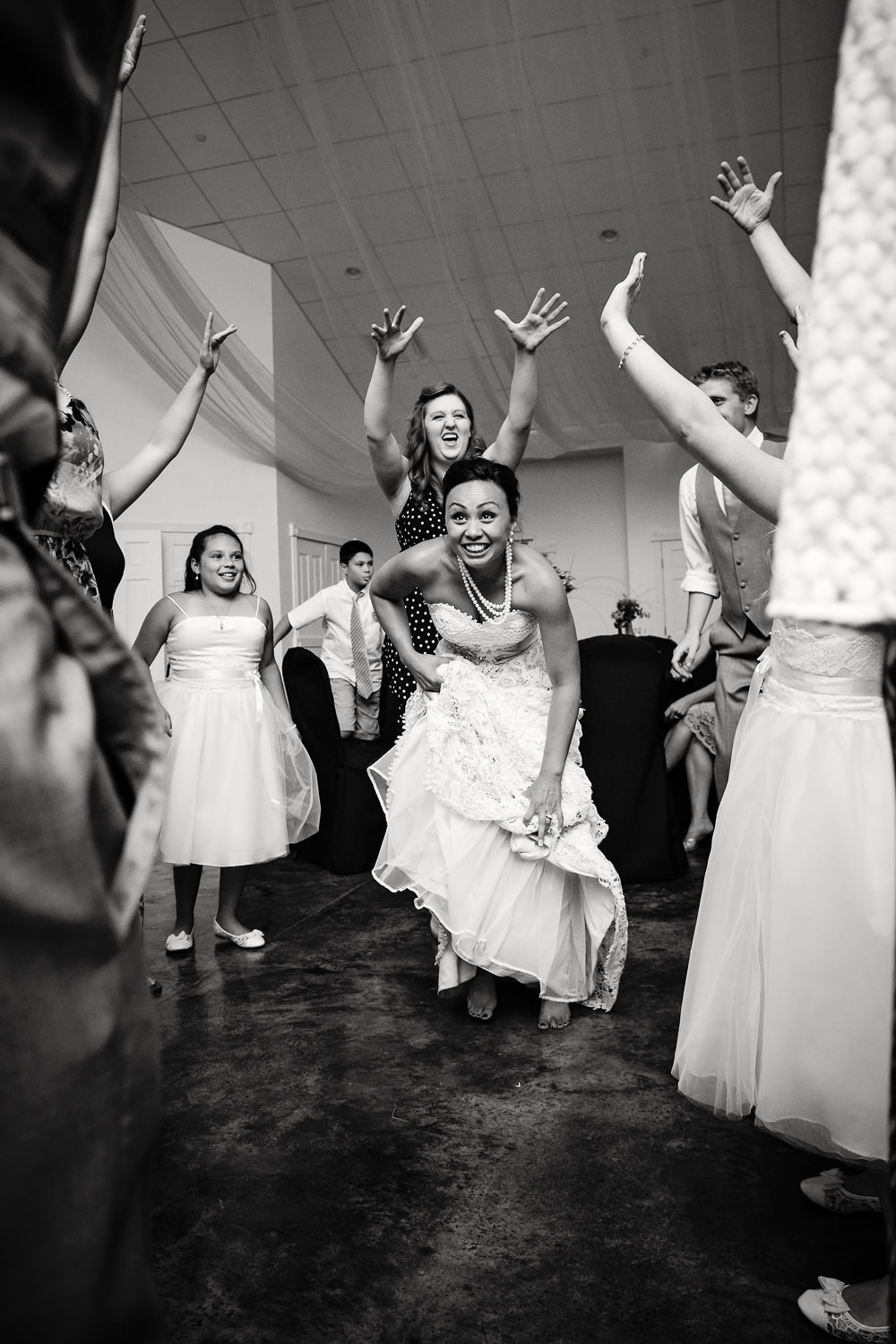 billings-montana-chanceys-wedding-reception-bride-dances-with-friends.jpg