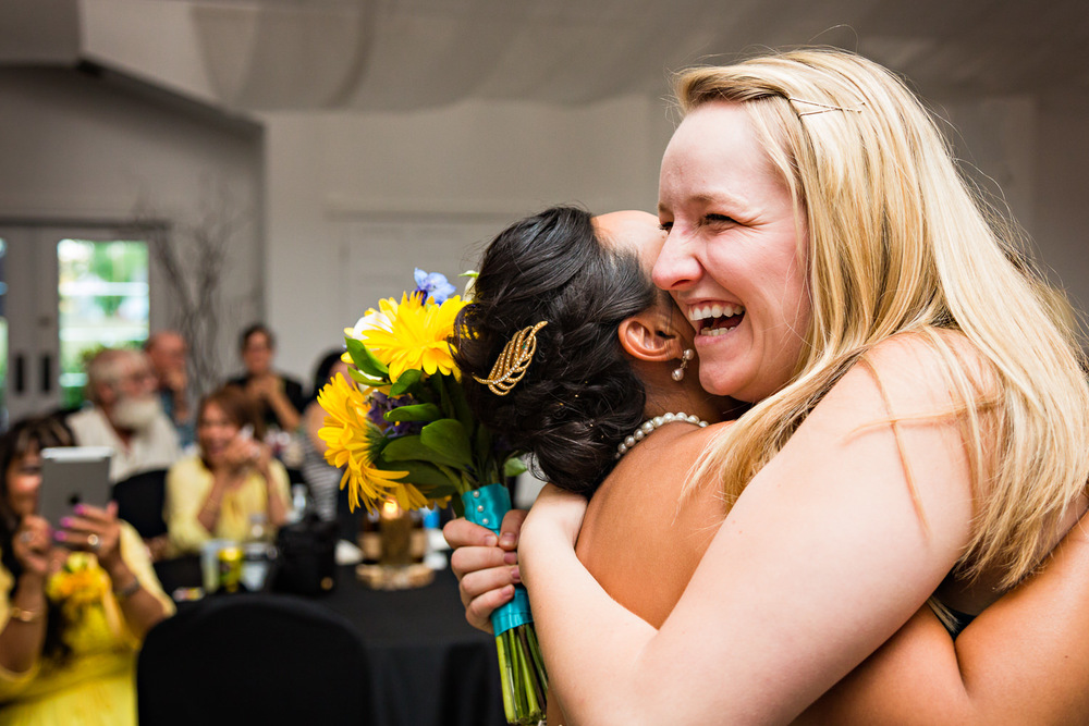 billings-montana-chanceys-wedding-reception-bride-hugs-bouquet-catcher.jpg