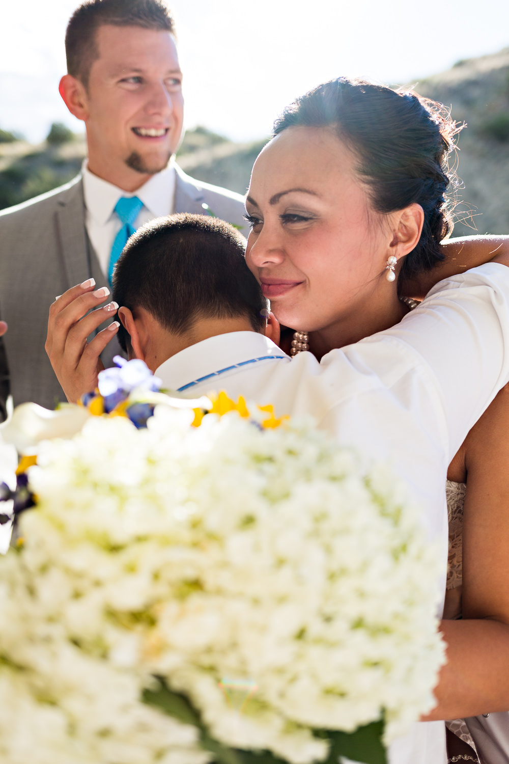 billings-montana-chanceys-wedding-reception-bride-hugs-nephew.jpg