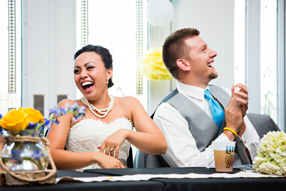 billings-montana-chanceys-wedding-reception-bride-laughs-during-toasts.jpg