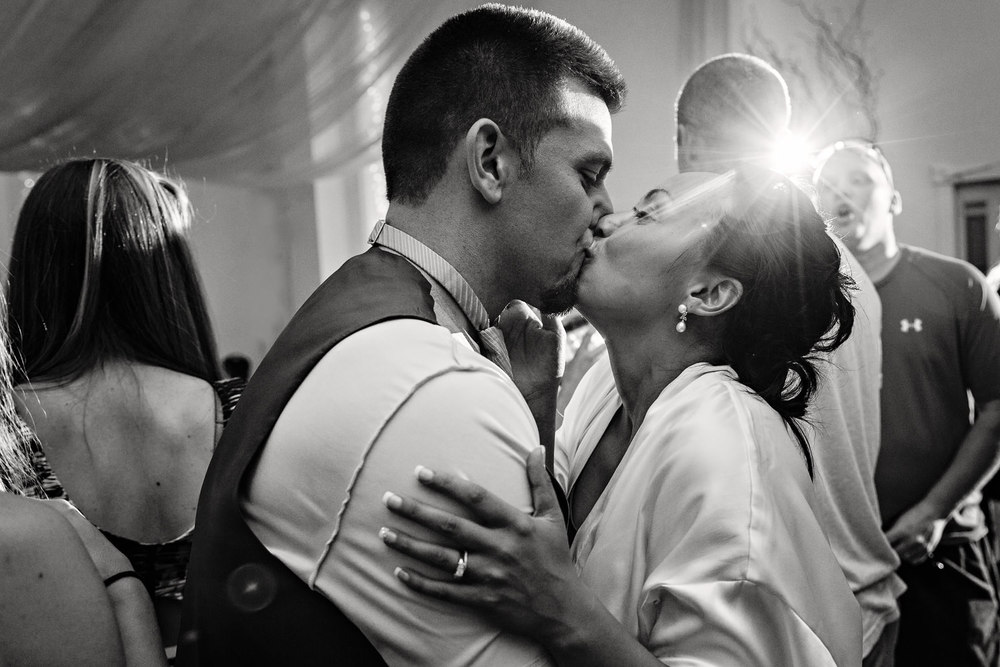 billings-montana-chanceys-wedding-reception-groom-bride-kiss.jpg