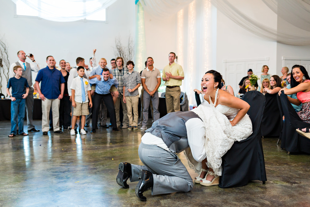 billings-montana-chanceys-wedding-reception-groom-retrieves-garter.jpg