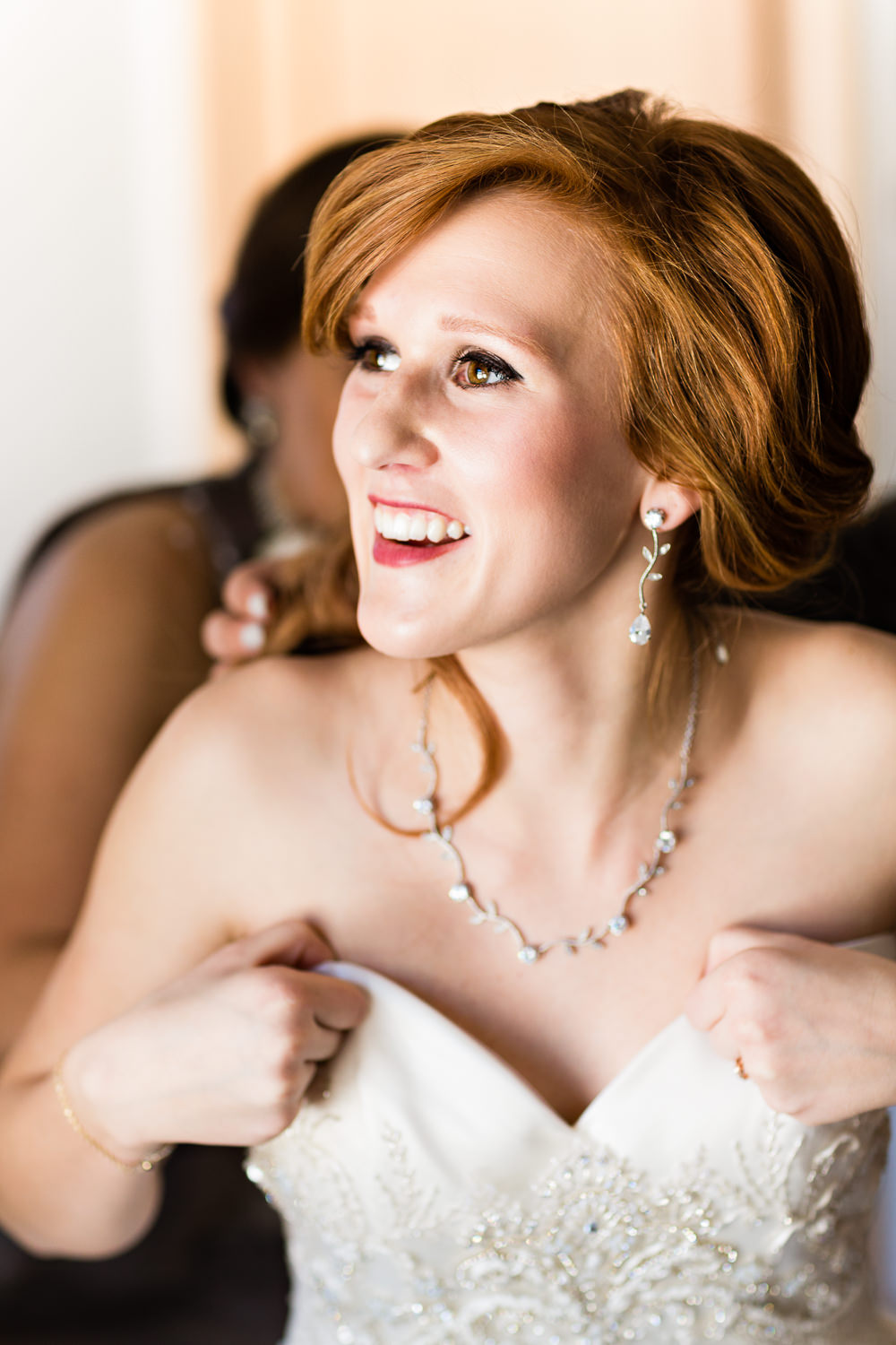big-sky-montana-winter-wedding-breanna-prep-bride-puts-on-dress.jpg