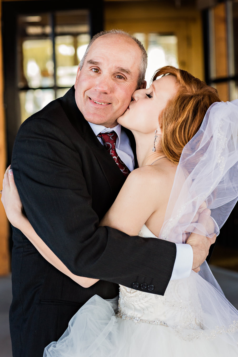 big-sky-montana-winter-wedding-breanna-father-first-look-bride-kisses-dad.jpg