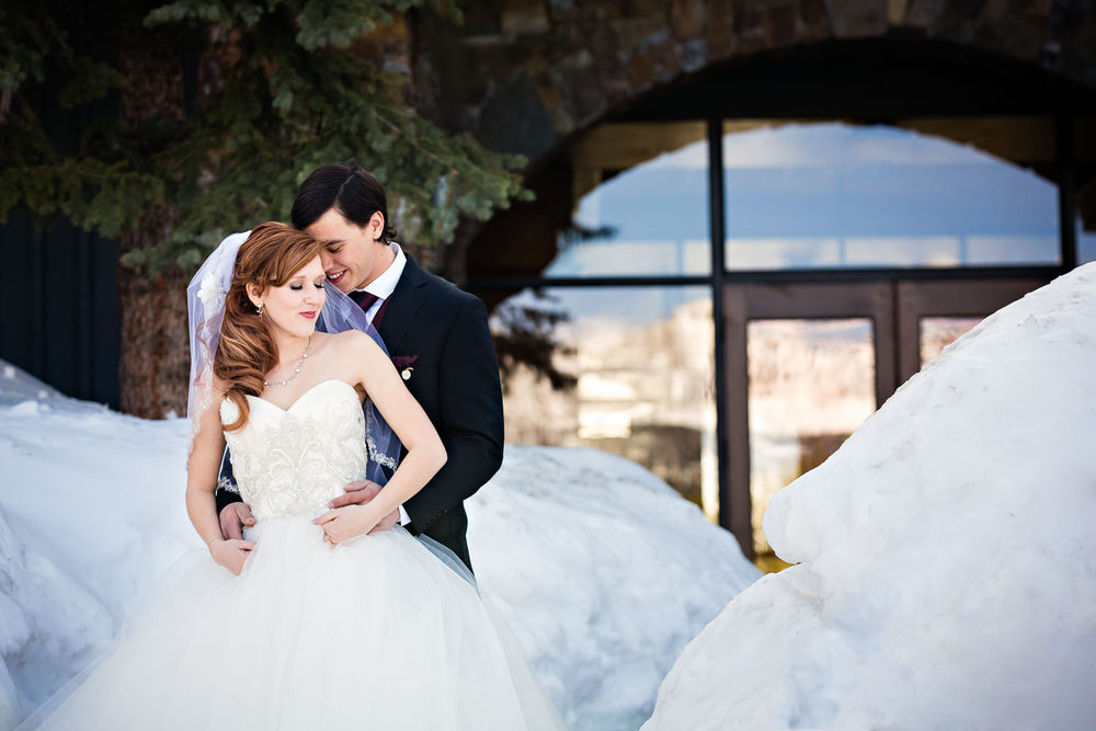 big-sky-montana-winter-wedding-breanna-first-look-bride-groom-in-snow.jpg