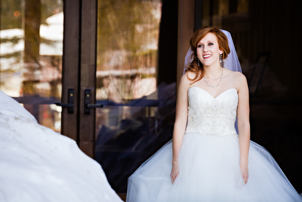 big-sky-montana-winter-wedding-breanna-first-look-bride-smiling.jpg