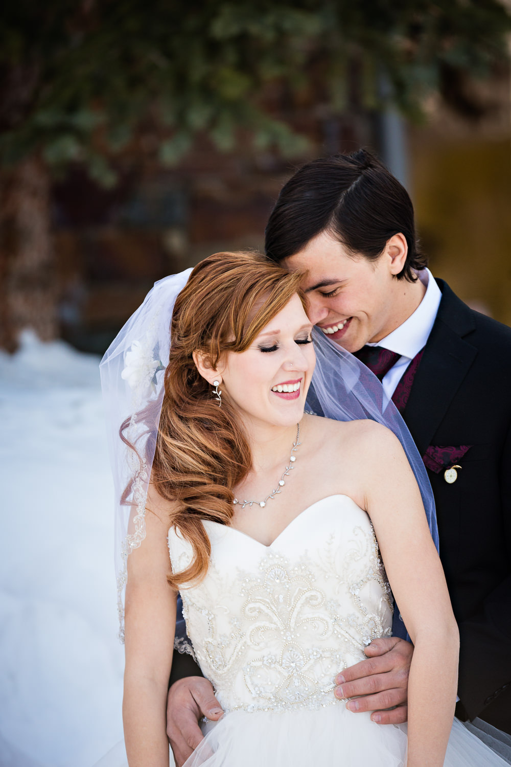 big-sky-montana-winter-wedding-breanna-first-look-groom-leans-against-bride.jpg