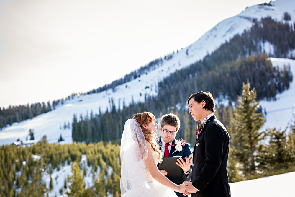 big-sky-montana-winter-wedding-breanna-ceremony-against-ski-mountain.jpg