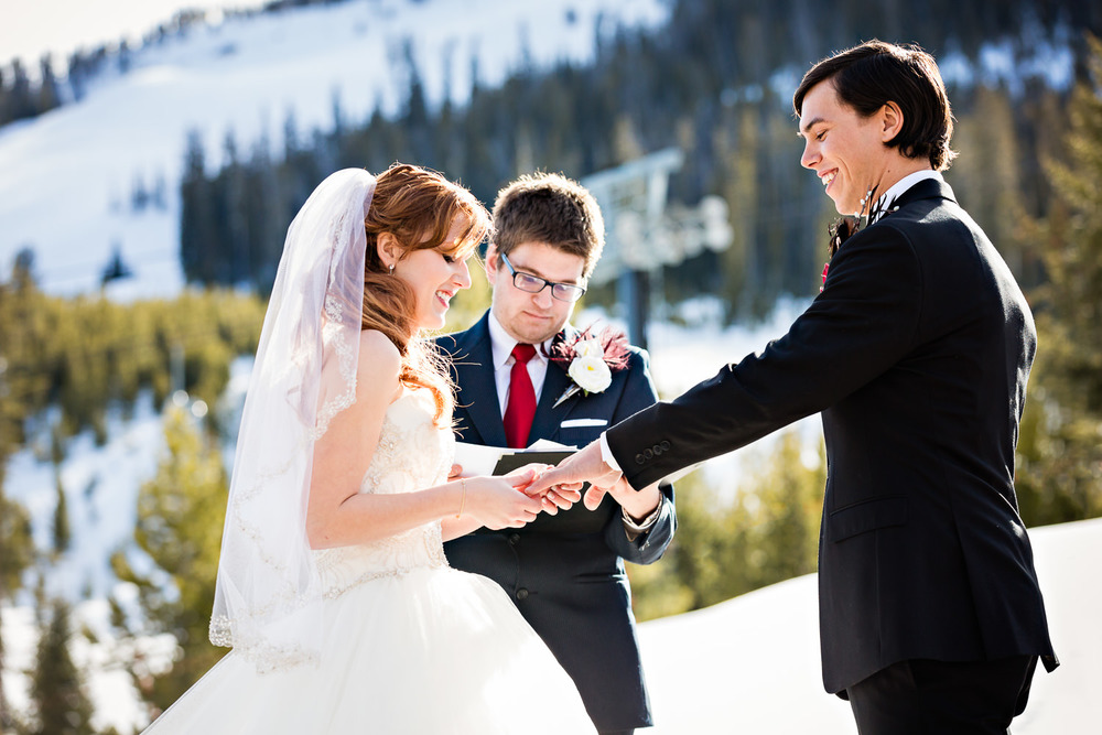 big-sky-montana-winter-wedding-breanna-ceremony-bride-exchanges-rings.jpg