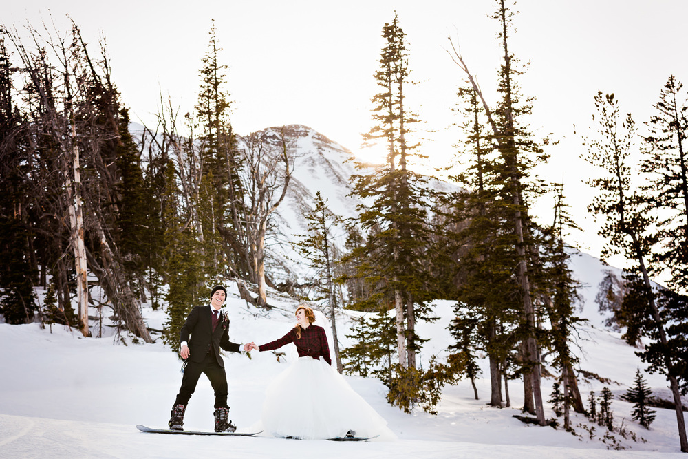 big-sky-montana-winter-wedding-breanna-formals-bride-groom-holding-hands.jpg